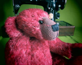 Artie is a beautiful red ted