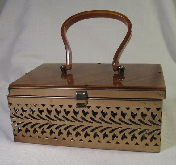 VTG Metal Cut Box Purse with Amber Lucite Top and Handle.