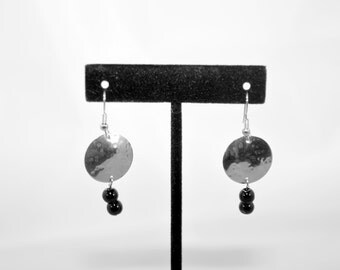 Small silver hammered and domed disc earrings with black glass beads