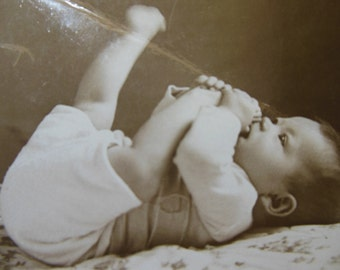 Old black and white photo of a baby