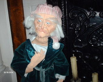 Ebenezer Scrooge Doll wearing his nightshirt robe and slippers.