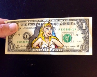 She-Ra painted on a one dollar bill.