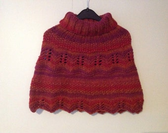 A beautiful hand knitted child's poncho