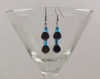 Antiqued silver disc earrings with blue accents.