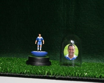 John Terry (Chelsea) - Hand-painted Subbuteo figure housed in plastic dome.