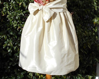 Sunny  Wide skirt in silk taffeta with bow at the waist
