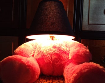 Need something pink and fluffy to light up your life? Pink headless Teddy Bear lamp is to the rescue.