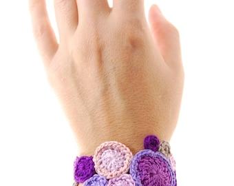 lilac cuff bracelet. crochet circle moons in purple, violet, blush pink handmade by Even Howard. Women's fiber art bracelet.