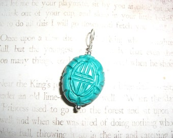 Turquoise colored stone and Sterling Pendant