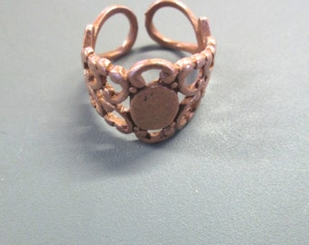 10  heavy duty COPPER filigree rings, with a 6x8mm glue on pad (lead and nickel free)
