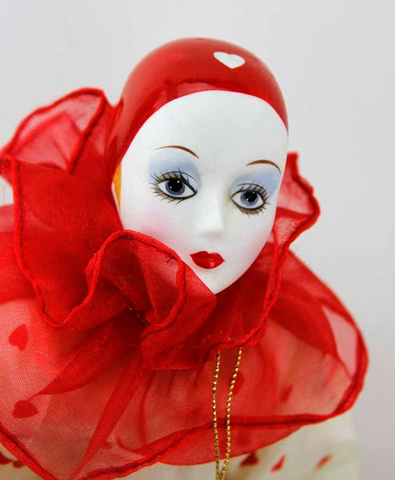 vintage red heart porcelain clown doll in red and white satin
