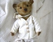 A smaller Hug! Hug Me Again collectible teddy bear by V. Galli. Traditional style and wel aged.