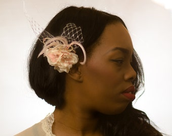 Silk floral and feather fascinator