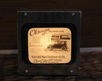 OLDSMOBILE AD #1 - Vintage magic lantern glass slide light box