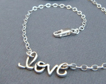 silver love bracelet. dainty sterling silver bracelet. cursive word bracelet. simple delicate jewelry. romantic special gift for women