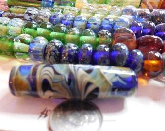 2 inch focal bead cobalt ,cream and green swirls,hand made,lamp work,borosilicate,one of a kind.