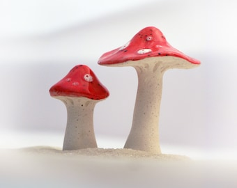 2 ceramic mushrooms with speckled red and white glaze