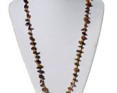 Brown stone and tube long strand necklace with brown stone heart pendant