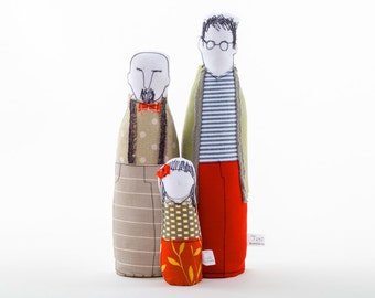 Gay family ,Proud family. Two men, fathers dolls in stripes and dots green red beige & girl wearing red dress with leaves, timo eco dolls