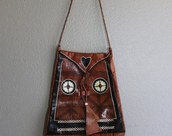 Brown leather ethic bag with fringe