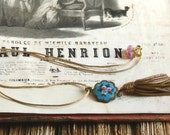 One of a kind assembly necklace with antique enamel button, real gold passementerie tassle. Blue, pink, pearl, swarovski crystal tassel