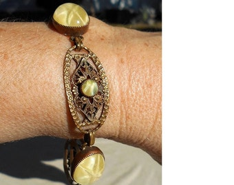 "SALE Antique Brass Hammered Ovals & Raised Filigree Yellow Glass Star  7 5/8"" Long Closed Bracelet. Only  19.90"