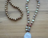 Long beaded, hand-knotted necklace with a double stone pendent