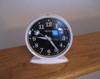 Vintage alarm clock by Advance.  White metal.  Retro.