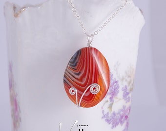 Beautiful agate pendant with sterling silver wire shapes, very modern, 35mm, OOAK, red orange, tangerine striped agate