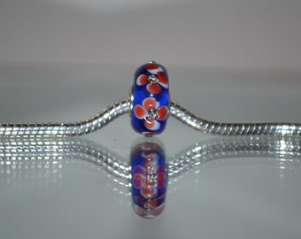 EB-414  Blue Glass Bead with Center Flower and Rhinestone Center