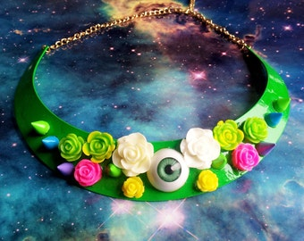 Bright green metal collar with eye spikes and roses