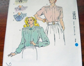 "1980s Blouse with collar variations sewing pattern Kwik Sew 1902.  Size XS-S-M-L-Xl Bust 31.5-32.5-34-35.5-37-38-40-41.5-43-45"" Uncut"