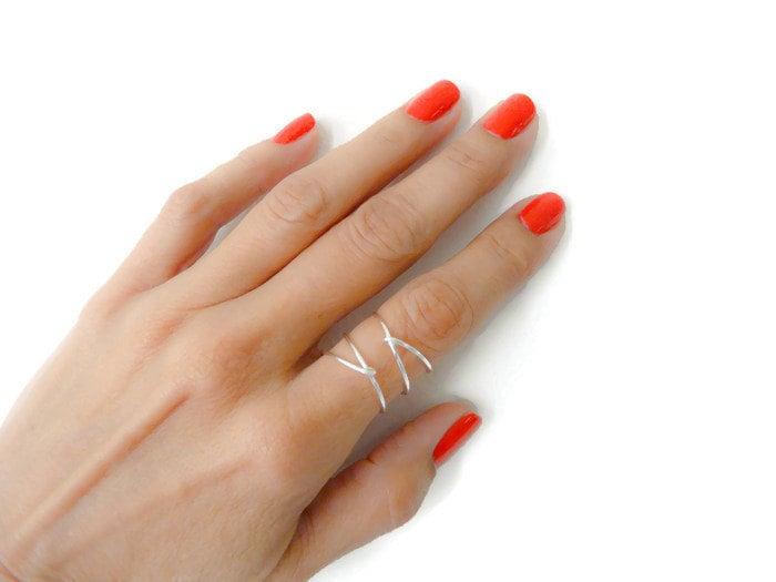 Criss Cross Ring On Pointer Finger