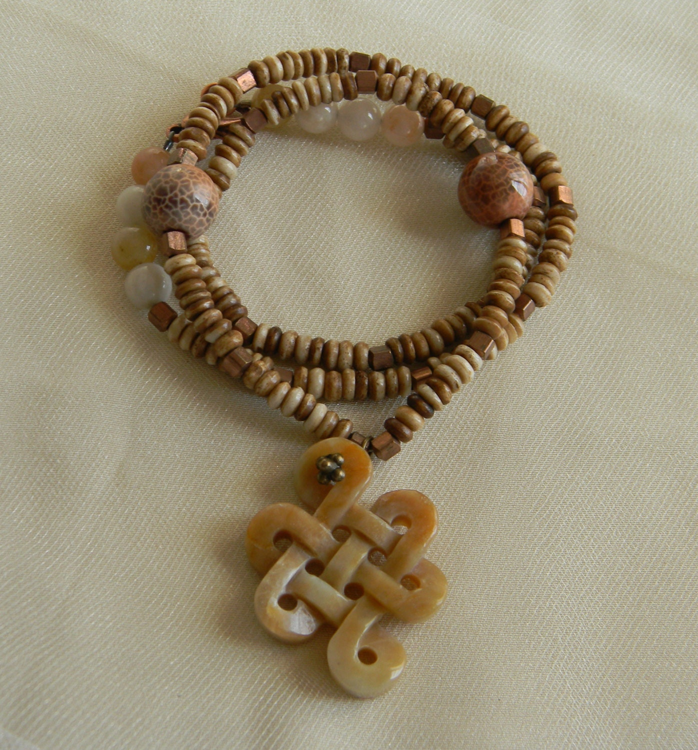 carved jade infinity knot pendant w bone necklace