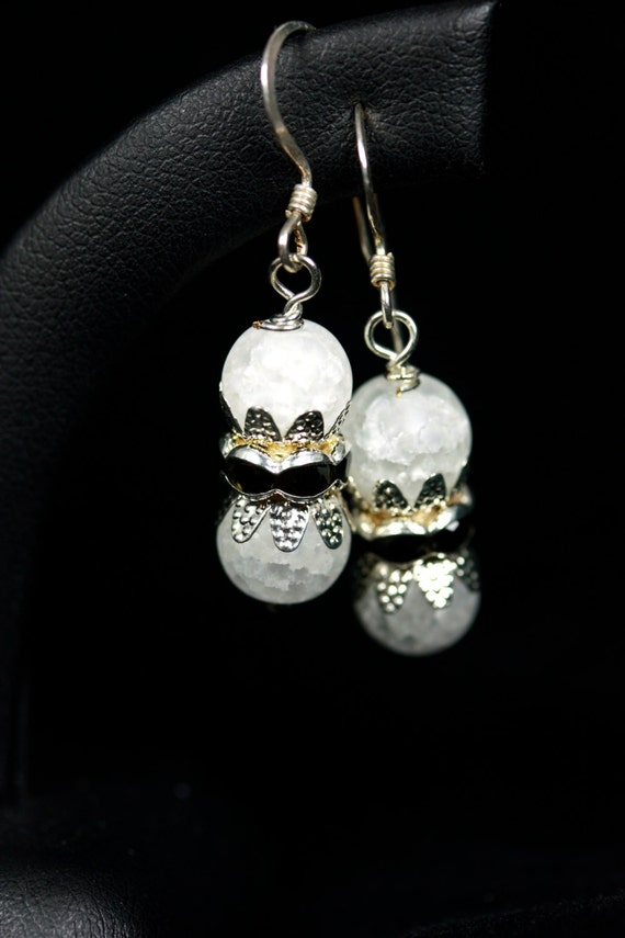 white black and silver earrings on sterling silver