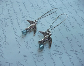 Silver bird earrings with blue crystal