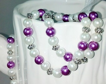 Set of Two Lavender and White Pearls Stretch Bracelets.