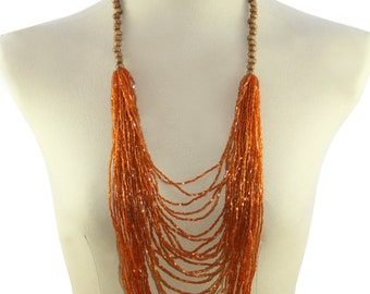 Long Beaded Orange Necklace with wooden accents.