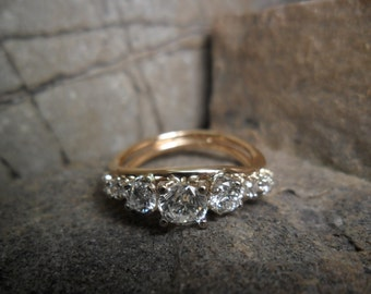 14K yellow gold ring set with diamonds