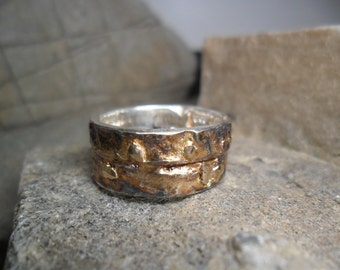 Bangle in sterling silver crosslinked and oxidized with fusion of yellow gold
