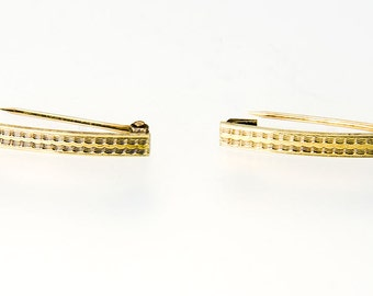 Matched pair of 14k lingerie pins finely engraved design