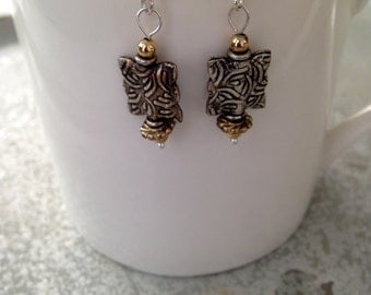 Silver and gold metal bead earrings.  1 in drop.