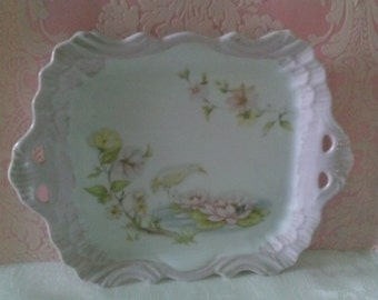 Lovely little pink scalloped edge ceramic tray.
