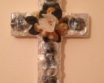 Cross embellished with seashells