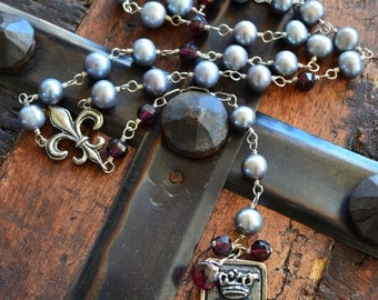 Rosary style grey pearl and garnet Y necklace with silver fleur de lis and heart crown pendant