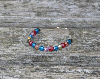Bracelet with colorful bohemian beads on gray cable thread, silver clasp and star on the back