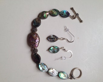 Abalone bracelet with matching earrings.