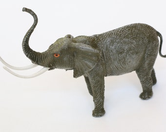 Vintage Toy Elephant with Long Tusks