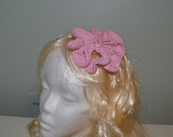 A crochet fascinator decorated with faux pearls