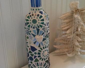 Jeweled Beach Bottle. Found Bahamian sea glass, cathedral glass in blues, greens, purples, Italian milifiori & smalti, white coral.